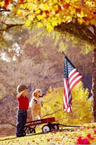 Kid and Dog Solute the American Flag