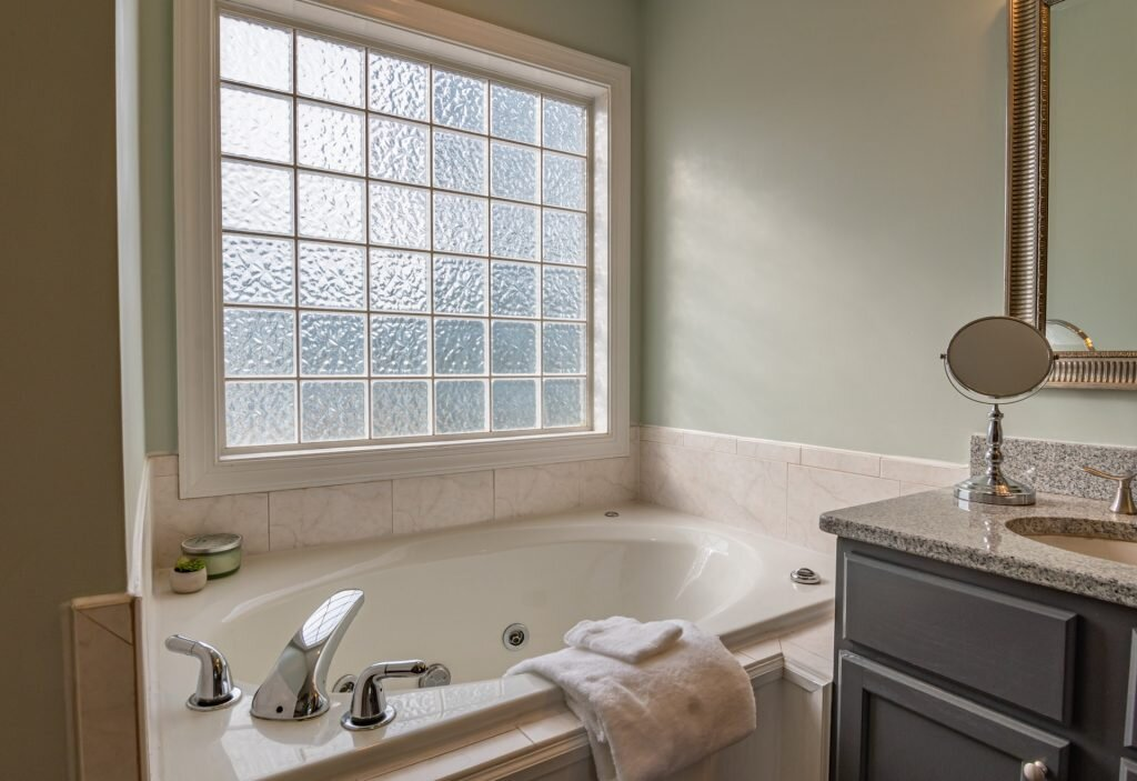 Carefully consider windows and ventilation before adding another bathroom to your new home.