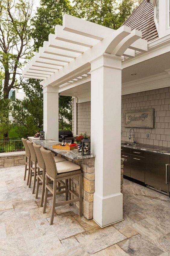 Outdoor kitchen with breakfast bar