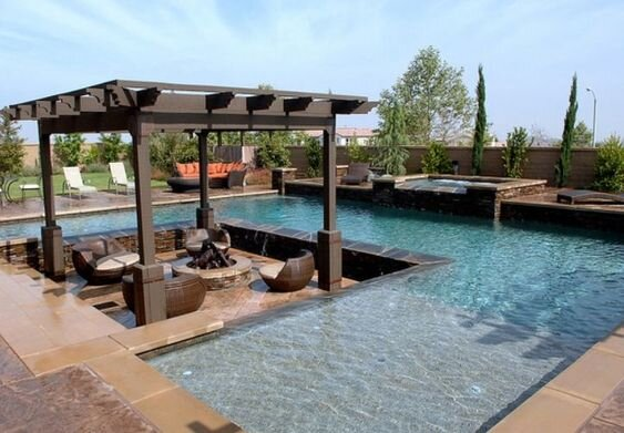 Outdoor fire pit with sitting area in between the pool